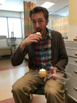 Mike eats his (not chemo laced) cupcake.